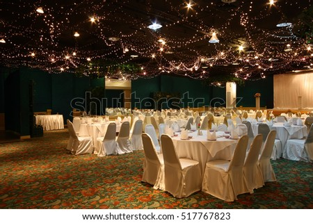 christmas lighting or wedding chinese style with dining table in hall for celebration on light shining in the hotel