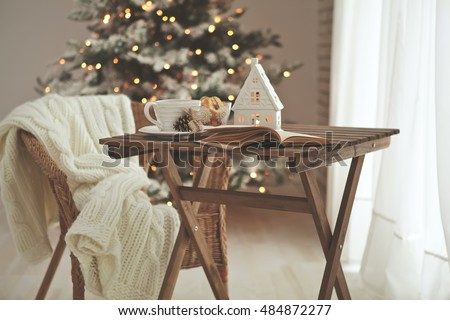 Christmas or new year decoration on modern wooden coffee table.  Living room interior and holiday home decor concept. Toned picture
