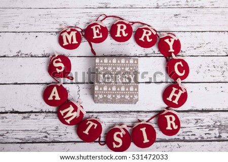 Christmas present on white wooden background in vintage style