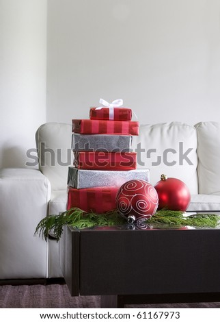 Christmas Presents And Red Ornaments On Table In Modern Living Room Part 67
