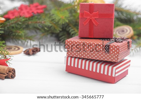 Christmas presents close-up on a background of Christmas decorations.