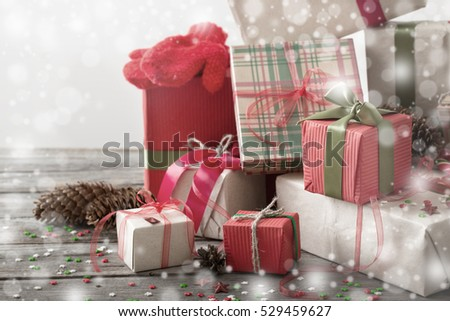 Christmas presents on old wooden table