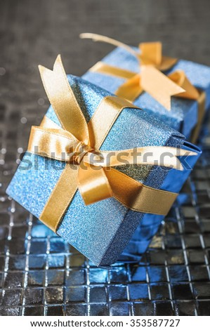 Christmas presents on silver background