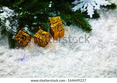 Christmas presents with evergreen branches