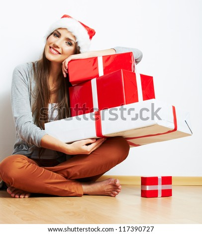 Christmas Santa hat isolated woman portrait hold christmas gift. Smiling happy girl on white background.