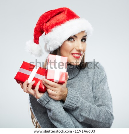 Christmas Santa hat isolated woman portrait hold christmas gift. Smiling happy girl on white background. Close up female portrait