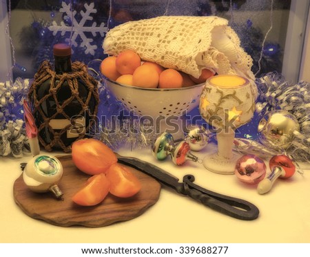 Christmas table with fruit, tangerines, persimmons and alcohol. Christmas toys, retro, old style picture