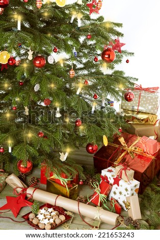 christmas tree against white background with lots gifts
