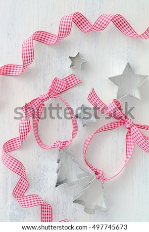 Christmas tree and star cookie cutters with ribbon