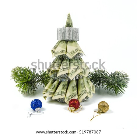 christmas tree by dollars and christmas decorations with pine on white