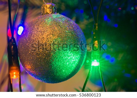 Christmas tree green closeup with a garland
