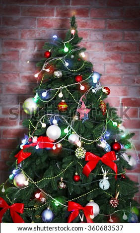 Christmas tree on a brick wall background