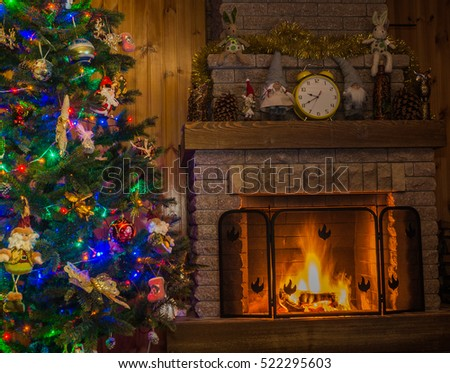 Christmas tree with toys in front of the fireplace in a country house.