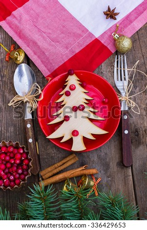 Christmas wooden table covered with a tablecloth on it tablecloth, decor