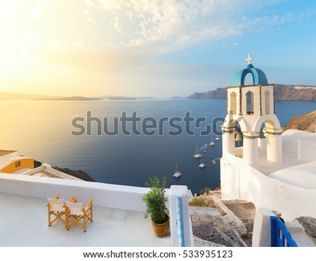 Church in Oia with traditional cycladic belfry, Santorini, Greece. Panoramic image.