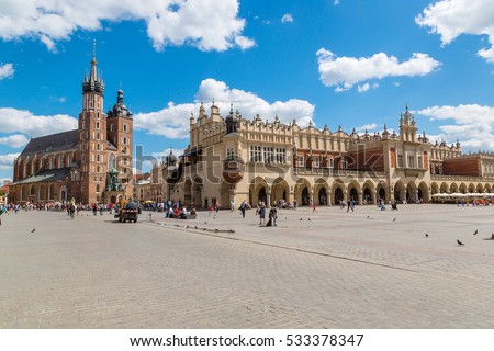 Church of St. Mary and the Cloth Hall on the main market square in Krakow in a beautiful summer day, Poland