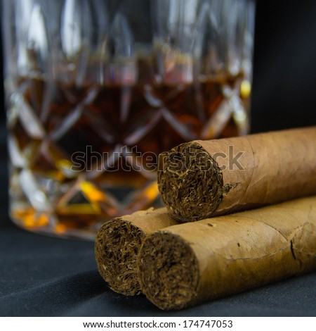 Cigar with glass of whisky