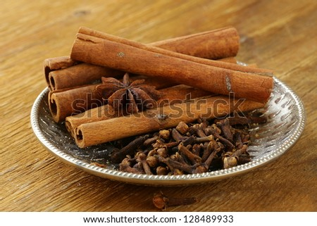 cinnamon, anise and clove on a silver plate