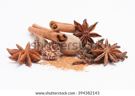 Cinnamon, anise, nutmeg, and cloves isolated on white background