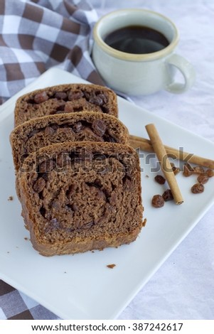 Cinnamon chocolate raisin bread with a cup of coffee