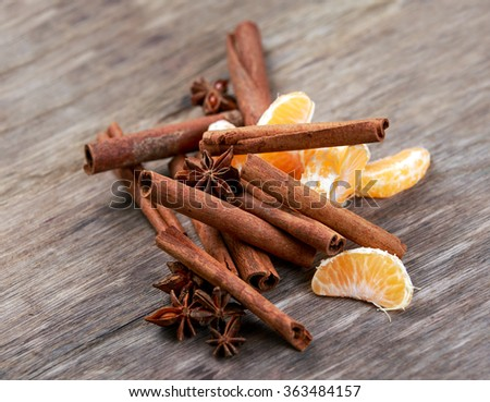 Cinnamon sticks and anice on wooden table. selected focus.