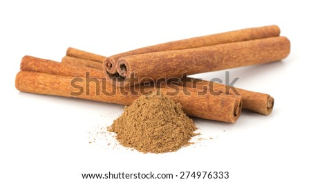 Cinnamon sticks with powder on white background