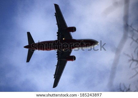 CIRCA FEBRUARY 2014 - BERLIN: an airplane on its way to arrive at tegel airport in Berlin.