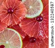 Citrus slices background - grapefruit and lime, square - stock photo