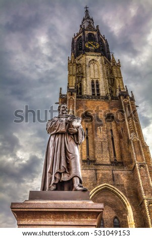City center with Grote Markt, churches and the statue of Hugo Grotius, Delft, Holland. HDR Image.