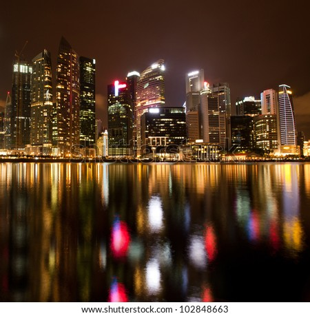 City of Singapore at night, Marina Bay with water reflections.