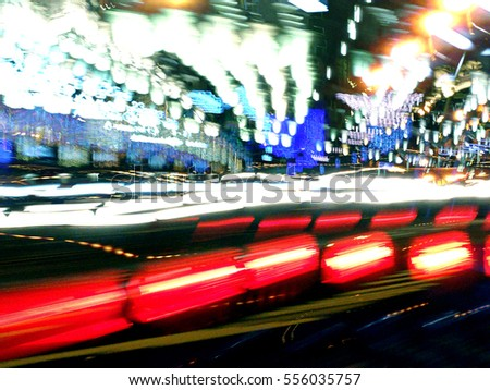 city traffic at night. soft focus with motion blur.