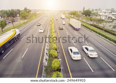 City transport - cars traveling on highway in daytime