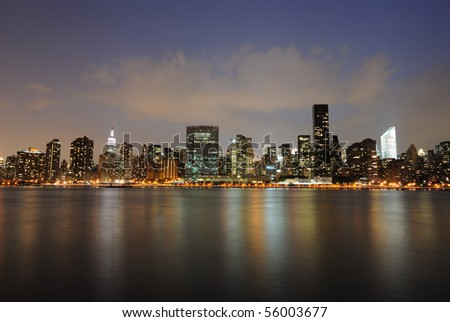 Cityscape of Midtown Manhattan across the East River at night.