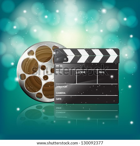 clapper and film on starry background