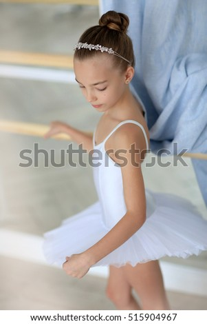 classes at the ballet school of the young dancer running in the mirror