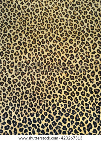 Classic black and yellow leopard fabric background.