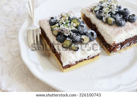 Classic Chester Cake slices with blueberries and Cilantro flowers on white plate