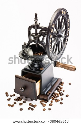 Classic Coffee Grinder with coffee beans on white background
