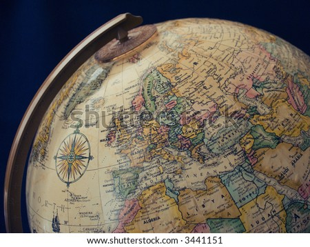 Classic globe with compass showing the western hemisphere.