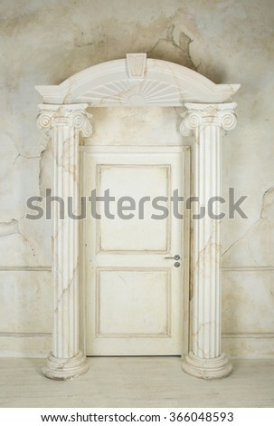 Classic interior with columns and closed door
