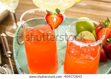 Classic lime and strawberry margaritas on the rocks.