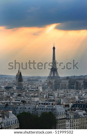 Classic panorama of Paris in France. View of sunset from Notre Dame de Paris. Eiffel tower in the right side. Skyscrapers and office buildings in a background.
