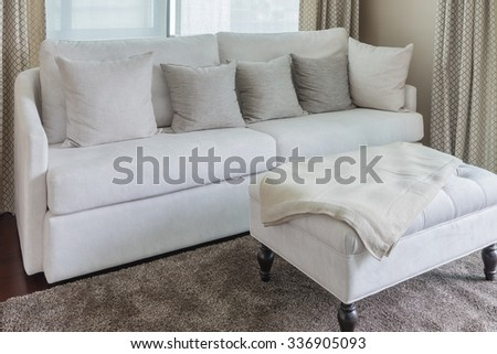 classic sofa style with pillows on carpet in living room