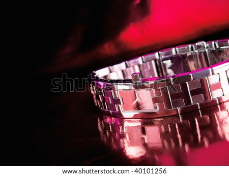 classic woman's watch on a red  background