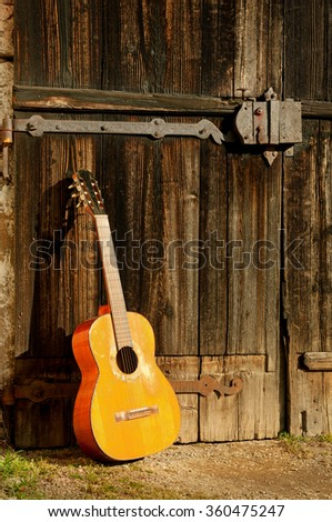 classical guitar in front of old wooden door 3