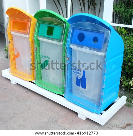 classify bins for recycle,Thai Language yellow is general waste,green is plastic bottle,blue is can and glass bottles