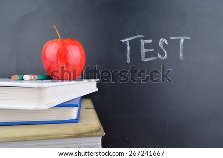 Classroom with apple,books and blackboard