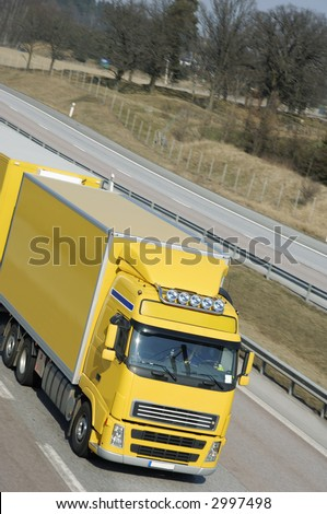 clean yellow truck driving on highway