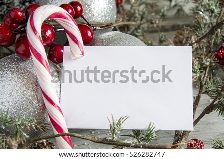 Clear paper laying with candy cane. Horizontal studio shot