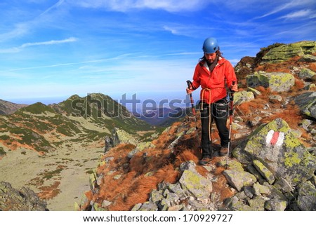 Climber carrying a rope descends from the summit